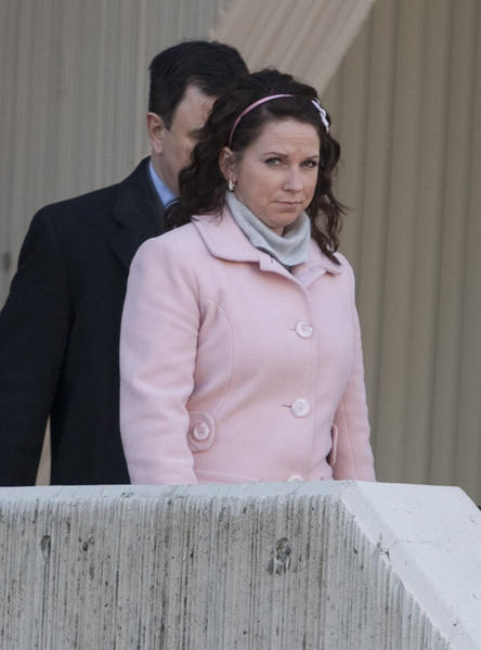 Ashley M. Blumenshine leaves the Will County Courthouse in Joliet on March 2, 2011, following a pre-trial hearing.
