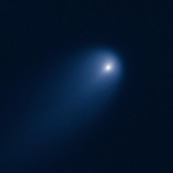 "Comet ISON, which experts say may become ""the comet of the century"" by the time it approaches Earth in late November, is photographed April 10 by the Hubble Space Telescope."