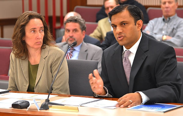 Jeanne Singer, left, and Dr. Mitesh Kothari, co-chairs of the Greater Hagerstown Committee's Education Forum, present a plan that would create a program that would provide money for all graduating seniors with tuition assistance and fees for two years of postsecondary education at a local institution.