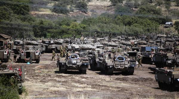 Israeli tanks sit near the Syrian border in the Golan Heights before the start of a military exercise.
