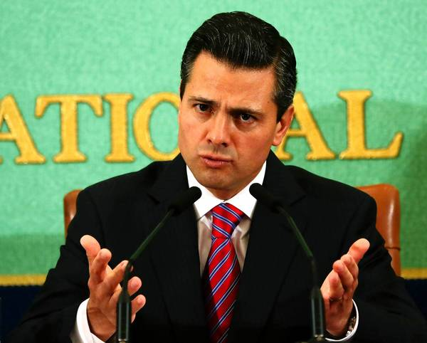 Mexican President Enrique Pena Nieto speaks this month at a news conference in Tokyo, where he was hoping to drum up investment. Pena Nieto is facing the biggest political crisis of his young presidency with the release of audio recordings in which elected officials from his party can be heard discussing ways to use a government anti-poverty program to secure votes in upcoming elections.