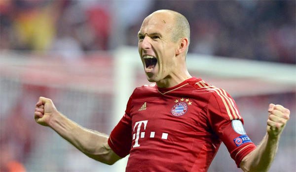 Munich's Arjen Robben celebrates after scoring the 3-0 lead during the UEFA Champions League semi final first leg soccer match between FC Bayern Munich and FC Barcelona in Munich, Germany.