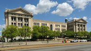After deadlock, city school board renews contract of Hopkins-run school