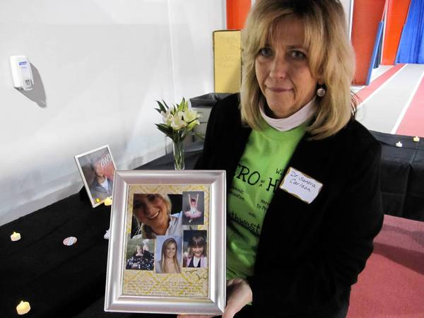 Sandra Carlson, a counselor from Bolingbrook, holds photos of Anna Marinier, a 20-year-old Frankfort woman who died of a heroin overdose in November.