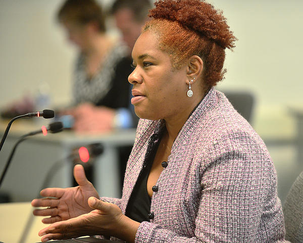 Nicole Ingram of Hagerstown speaks to the Washington County Board of Education Tuesday during a public hearing about the proposed redistricting of Pangborn and Paramount elementary schools, which would affect two of her children.