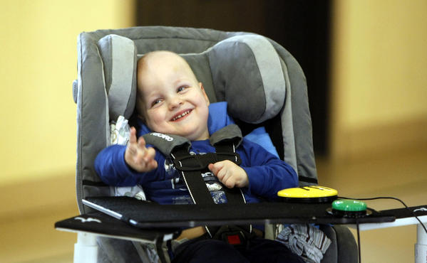 Austin Rousselow, 2, is all smiles in his Little Tykes Hummer vehicle modified by Notre Dame engineering students so Austin, who has cerebral palsy, can operate the vehicle on his own.