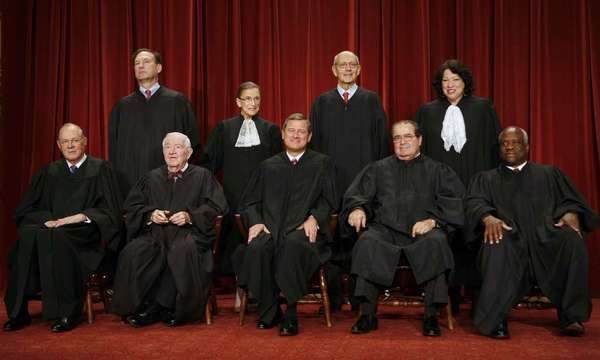 The justices of the U.S. Supreme Court pose for their official photo in Washington, D.C., U.S., on Tuesday, Sept. 29, 2009. Sitting from left in front are Anthony Kennedy, John Paul Stevens, John G. Roberts, the chief justice, Antonin Scalia and Clarence Thomas. Standing at rear are Samuel Alito, Ruth Bader Ginsburg, Stephen Breyer and Sonia Sotomayor.