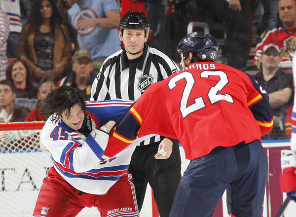 SUNRISE, FL - APRIL 23: Arron Asham #45 of the New York Rangers and George Parros #22 of the Florida Panthers fight during first period action at the BB&T Center on April 23, 2013 in Sunrise, Florida. (Photo by Joel Auerbach/Getty Images) ORG XMIT: 164613383