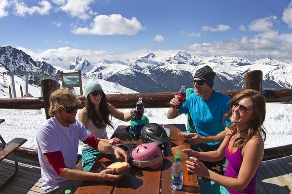 Skiers take a break from a spring day on the slopes at Blackcomb Mountain above Whistler, Canada. The ski/snowboard season has been extended until May 27 because of heavy snowfall.