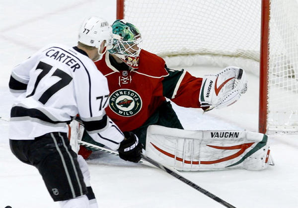 Minnesota Wild goalie Niklas Backstrom (32) stops a shot by Kings center Jeff Carter (77) during the first period.