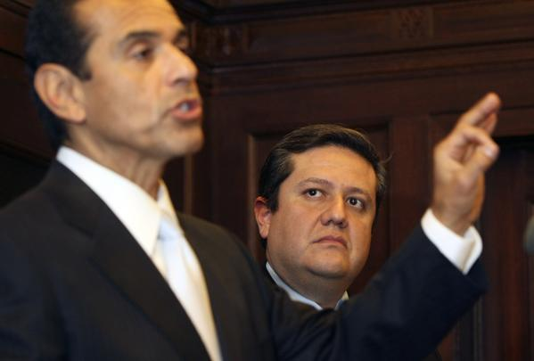 """If labor concessions and police overtime controls are not achieved,"" says a report from Miguel Santana, right, the city's chief administrative officer, ""the deficit for 2014-15 balloons to $267 million and the outlook will no longer show a surplus in 2017-18 but a deficit of $93 million."" At left is Los Angeles Mayor Antonio Villaraigosa."