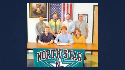 North Star's Brantley Rice signs a national letter of intent to play baseball at the University of Pittsburgh at Johnstown. He is joined by, from left, his parents (seated) Stoney and Tammy Rice, (standing) high school principal Lou Lepley, head coach Chris Evans, assistant coach Mike Blucas and athletic director Stacy Schmitt.