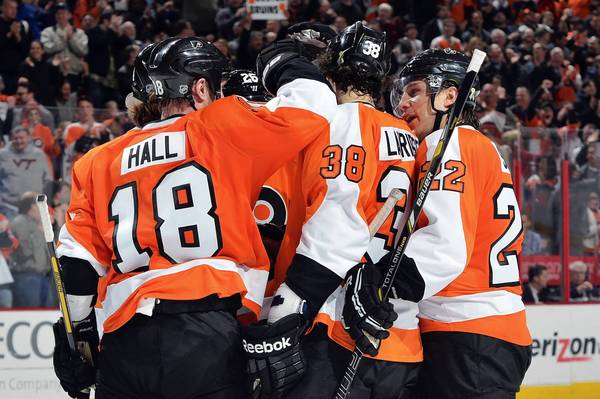 Adam Hall #18, Ruslan Fedotenko #26 and Luke Schenn #22 of the Philadelphia Flyers congratulate teammate Oliver Lauridsen #38 on his first NHL goal during the game against the Boston Bruins at the Wells Fargo Center on April 23, 2013 in Philadelphia, Pennsylvania.