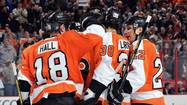 Matt Read and Oliver Lauridsen scored goals seven seconds apart in the second period to help the Philadelphia Flyers beat the Boston Bruins 5-2 Tuesday night at the Wells Fargo Center.