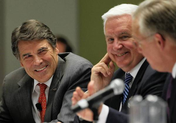 Texas Gov. Rick Perry, left, attends the BIO International Convention on Tuesday at McCormick Place.
