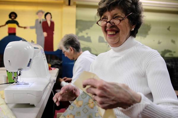 Arlene Reiter, of St. Charles, shares a laugh with the Sewing Circle quilting group in Geneva. The traditional art of quilting is thriving in bees throughout the area, as women — and an occasional man — gather to socialize and sew handicrafts for charitable causes.