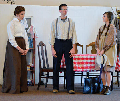 In Northern Plains Christian Academys production of Anne of Green Gables, Shanya Gross, left, plays Marilla; Zachery Chamberland, center, portrays Matthew; and Julia Hannahs, right, is Anne.
