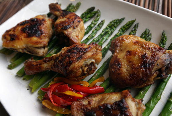 Fresh lemons, olive oil and Dijon mustard are paired with chicken, asparagus and sweet mini bell peppers in this dish.