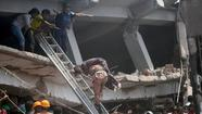 An eight-story building housing several garment factories collapsed near Bangladesh's capital Wednesday morning, killing at least 70 people and trapping many more in the rubble, officials said.