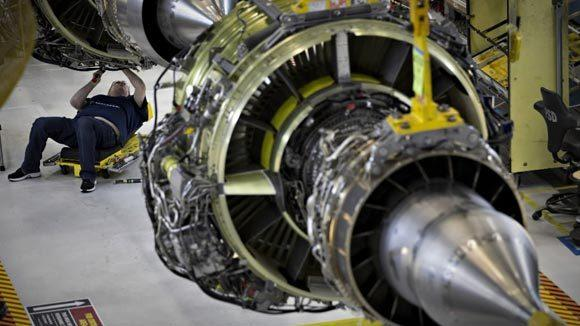 A worker builds an engine for the Boeing 737-900 at their assembly operations in Renton, Wa. in 2012.
