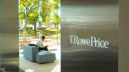 T. Rowe Price Group reported Wednesday that profit rose 22 percent in the quarter from a year ago to $241.9 million, buoyed by an uptick in the market that pushed assets under management to a new record.