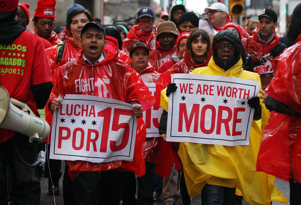 "Workers march for the ""Fight For 15"" rally, organized by the Service Employees International Union along with nonprofit groups, which seeks wages of at least $15 per hour for low-skilled workers, during a protest outside Union Station today."