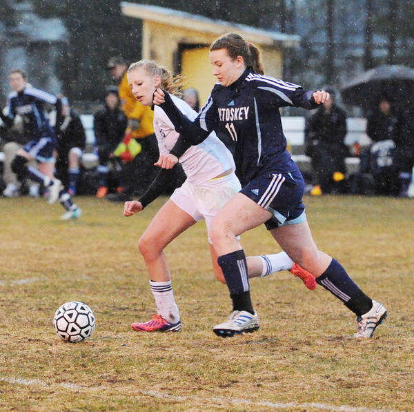 Petoskey senior Alyssa VanWerden (right) chases after a loose ball along with a Gaylord player during Tuesdays Big North Conference match at Gaylord High School. The Blue Devils defeated the Northmen, 1-0. Petoskey will travel to Cadillac for another league match on Thursday, April 25.