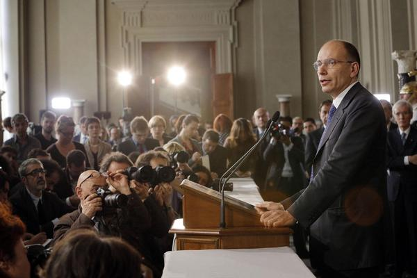 Enrico Letta, deputy leader of Italy's Democratic Party, talks to journalists Wednesday after being given a mandate to form a new government.