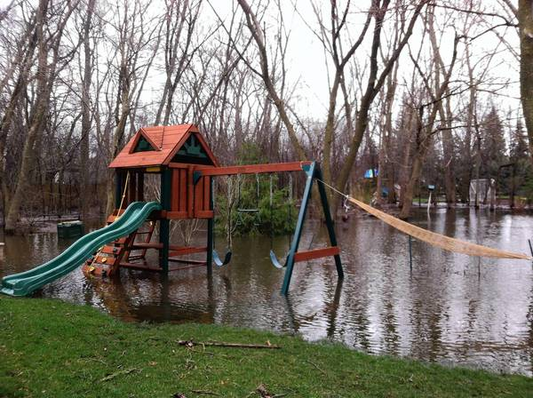 Rezzy Azzam's backyard near 60th and Fairview was completely underwater after last week's severe rainstorms.