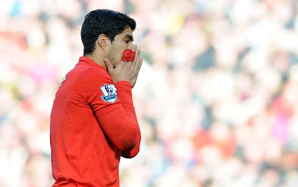 Liverpool striker Luis Suarez received a 10-game ban from the Premier League for biting an opponent.