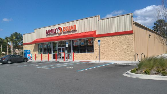 "Typical metal box in the middle of a sea of concrete. This Family Dollar off U.S. Highway 17-92 in unincorporated Seminole County is just about the cheapest design a developer can get away with. There is a ""stone"" facade on the front of the building, but the top and the three other sides are metal."