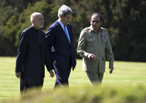 U.S. Secretary of State John F. Kerry, center, talks with Afghan President Hamid Karzai, left, and Pakistani army chief Gen. Ashfaq Kayani during a break in a meeting in Brussels.