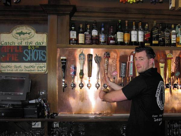 Tribes Alehouse bartender Nate Heun said he's supportive of craft beer brewers coming to Tinley Park. Tribes serves 52 different craft beers.