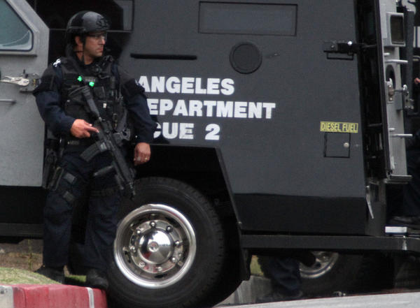 LAPD SWAT team members take positions around home on Meyler Street in San Pedro after a man locked himself inside the home, which is within a block of a private high school and Cabrillo Avenue Elementary School.