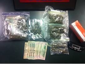 Police seized 298 grams of marijuana, $421 cash, drug packaging materials and drug paraphernalia from a man suspected of dealing the drug.