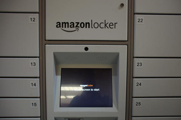A new Amazon delivery locker system, which routes Amazon shipments to a publicly-accessible locale, is viewed in a grocery store on November 16, 2011 in New York City. Instead of having packages delivered to a home or business address, the delivery locker system allows Amazon customers who live near a locker location to send it there and then collect it using a unique pick-up code. Currently there are eight locations spread across Manhattan.