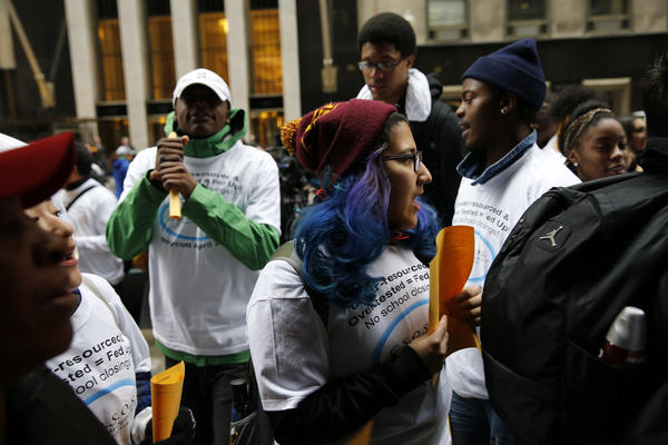 Students from across the city who are part of a newly formed group, Chicago Students Organizing to Save Our Schools, walk and protest on the sidewalk outside of Chicago Public Schools headquarters prior to the Chicago Board of Education meeting on Wednesday