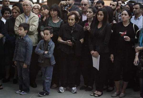 Armenian residents congregate in front of Burbank City Hall to commemorate the lives that were lost during the Armenian genocide at a memorial candle lighting on Tuesday, April 23, 2013.