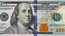 The Federal Reserve said Wednesday that a newly designed $100 bill would begin circulating in October, more than two years after the initial target date.