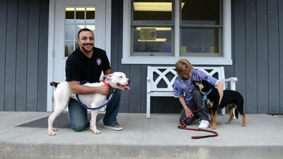 Office manager David Mayhugh and animal care provider Chris Sakalas pose with adoptable dogs, Sneezy, a 1.5 year old pitt bull and Addie, a 1 year old boarder collie on Wednesday at the Somerset County Humane Society.