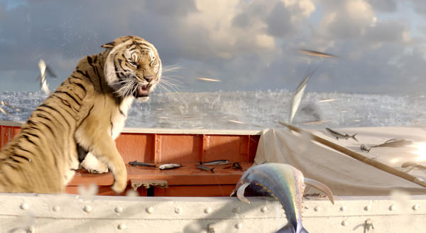 "The tiger Richard Parker reacts to the sudden appearance of a school of flying fish in ""Life of Pi."""