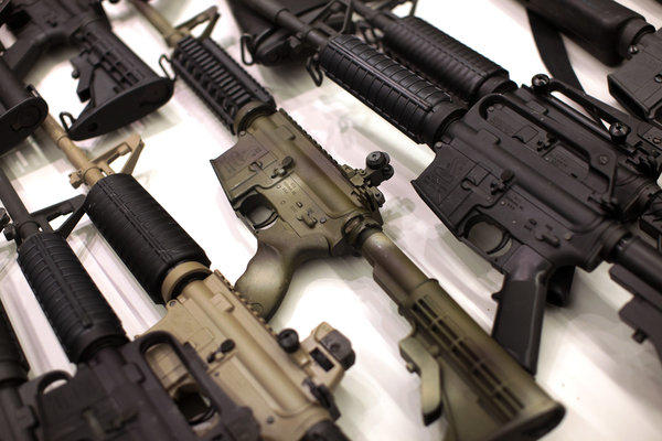 A collection of AR-15-style guns at a gun buyback program in Los Angeles