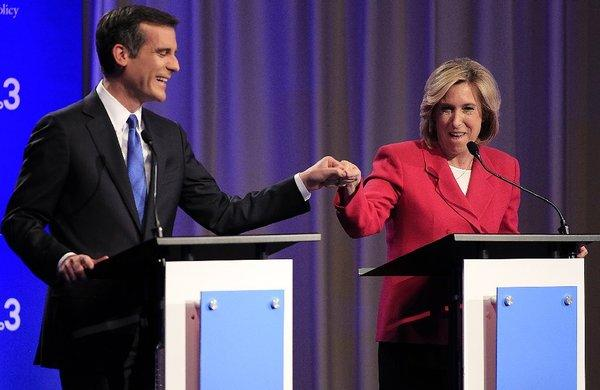 Los Angeles mayoral candidates Eric Garcetti and Wendy Greuel exchange a fist-bump before a debate this week.