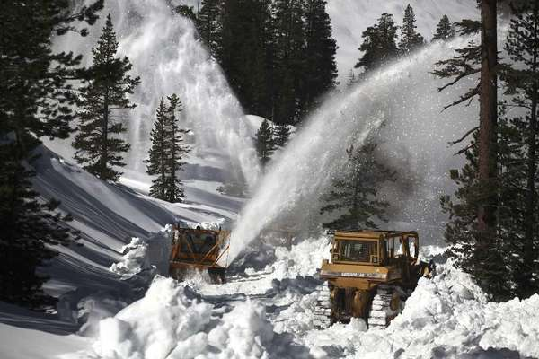 Road crews work to clear roads in Yosemite National Park during heavy snow in 2011.