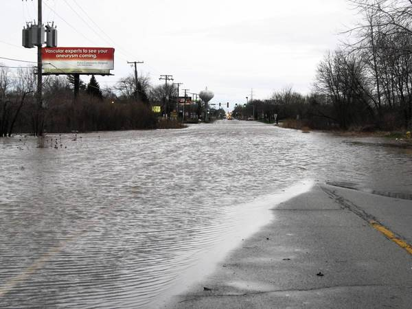 Standing water blocks Wolf Road south of 167th Street after more than 4 inches of rain fell in Orland Park on April 18.