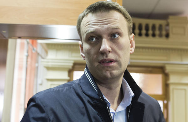 Russian opposition leader Alexei Navalny enters a courtroom in Kirov, Russia. Navalny is accused of embezzlement, but says the case is politically motivated.
