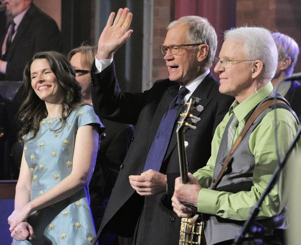 "Singer/songwriter Edie Brickell, left, and comedian/musician Steve Martin join host David Letterman after performing a song from their recently released album, ""Love Has Come for You."""