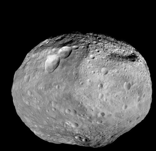 The giant asteroid Vesta is seen in a mosaic image taken by NASA's Dawn spacecraft in November 2012.