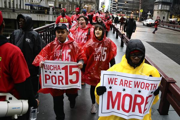 Workers protest outside Union Station in Chicago on Wednesday.