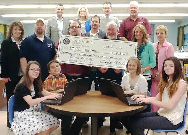 The Eagles Club of Waynesboro, Pa., recently donated more than $77,000 to the Waynesboro Area Business, Education and Community (WABEC) Foundation. That money was used to buy laptop computers for elementary schools. Pictured for the check presentation are - back row WABEC board members: Dave Neterer, Julie Sellers, Randy Sellers and Randy Kuhn; second row: Scott Michalsky, vice president of the Eagles Club; second row: Rita Sterner-Hine, Summitview Elementary School and a WABEC member; Joe Banzhoff, Eagles board member; Don Rhines, Eagles Club secretary; Todd Cloope, Eagles Club manager, Summitview teacher Katie Cook, Wendy Royer WASD Assistant Superintendent/WABEC board member. Front row: Summitview students - Payton Sampson, sixth grade, Logan Sampson, third grade; Lexie Kane, sixth grade; and Madison Kohler, sixth grade.